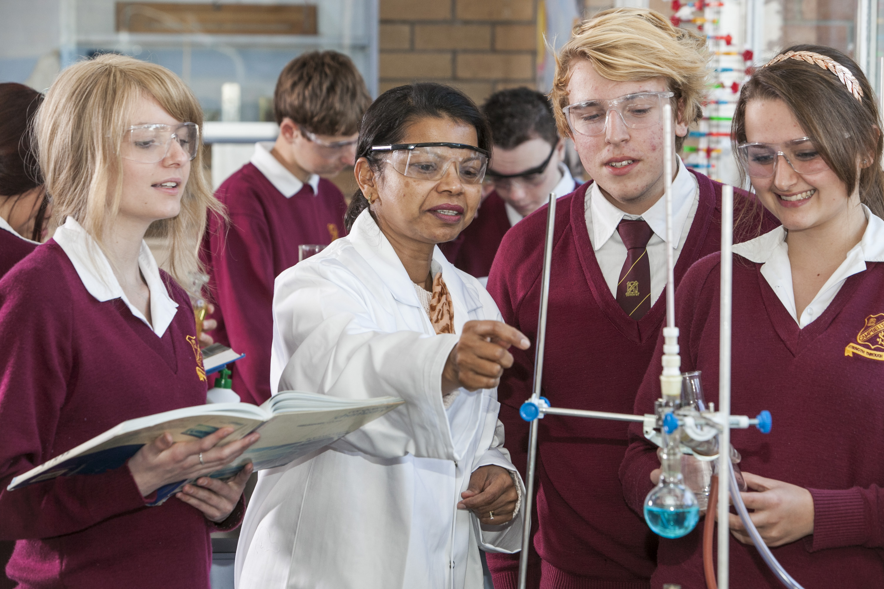 Students and teacher conducting a science experiment
